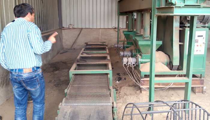 Columbia customer visit charcoal briquetts factory